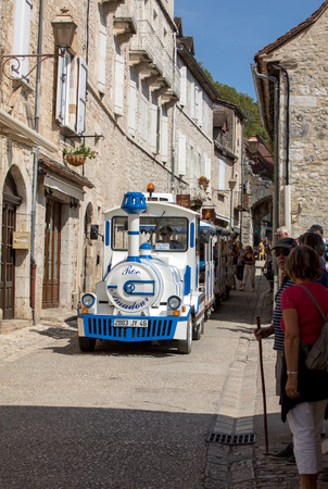 Rocamadour, France - September 3, 2018: Tourist train in pilgrimage town of Rocamadour, Episcopal city and sanctuary of the Blessed Virgin Mary, Lot, Midi-Pyrenees, France