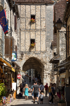 Rocamadour, France - September 3, 2018: Tourists walking in the medieval centre of Rocamadour. France 에디토리얼