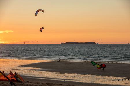 Saint-Malo, France - September 13, 2018: Sunset and Kitesurfers on the beach in Saint Malo,  Brittany, France