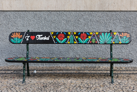Funchal, Madeira, Portugal - April 19, 2018: Artistically painted wooden bench  on Avenida Arriaga in Funchal. Madeira, Portugal