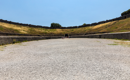 Pompeii, Italy - June 15, 2017: The oldest surviving Roman Amphitheatre in ancient city of Pompeii, Italy. Pompeii was destroyed and buried with ash after Vesuvius eruption in 79 AD 報道画像