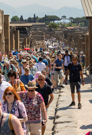 Pompeii, Italy - June 15, 2017:  The famous archaeological site of Pompeii. Crowd of tourists under the scorching sun.