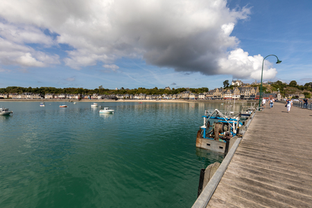 Cancale, France - September 15, 2018: Pier La Fenetre and port of La Houle in Cancale. Brittany, France.