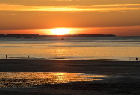 Beauty sunset view from beach in Saint Malo,  Brittany, France 免版税图像 - 127273887