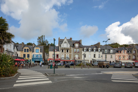 Cancale, France - September 15, 2018: Bars and restaurants on the main street in Canacle known for its delicious fish and seafood. Brittany, France