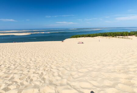 Dune of Pilat, France - September 10,2018: People on the Dune of Pilat, the tallest sand dune in Europe. La Teste-de-Buch, Arcachon Bay, Aquitaine, France Фото со стока