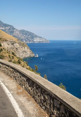 A winding and narrow road on the Amalfi Coast between Positano and Amalfi. Campania, Italy
