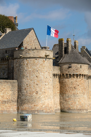 Le Mont-Saint-Michel, France - September 13, 2018: Le Mont Saint-Michel, medieval fortified abbey and village on a tidal island in the Normandy, France, at low tide