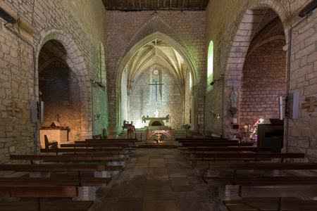 Carlux, France - September 7, 2018: Main nave and altar in Church of Saint Catherine in Carlux. Dordogne valley, Aquitaine,  France