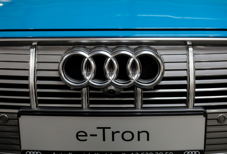 Cracow, Poland - May 18, 2019: Audi e-Tron metalic logo closeup on the car displayed at Moto Show in Cracow Poland. Exhibitors present  most interesting aspects of the automotive industry