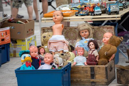 Cahors, France - September 15, 2018: Market day in Cahors, France. Old toys and dolls at the Cahors flea market