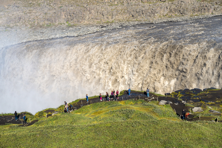 Dettifoss, Iceland - July 23, 2017: Dettifoss is the most powerful waterfall on Iceland . It is located in Jokulsargljufur National Park the northeasten Iceland on the river Jokulsa a Fjollum.