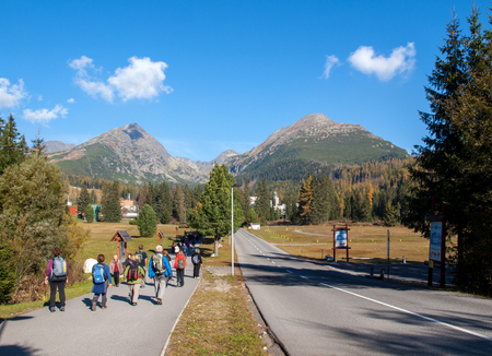Vysoke Tatry, Slovakia - October 9, 2018: Hikers on trail at Great Cold Valley,  Vysoke Tatry (High Tatras), Slovakia. The Great Cold Valley is 7 km long valley, very attractive for tourists