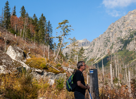 Vysoke Tatry, Slovakia - October 10, 2018: Hikers on trail at Great Cold Valley,  Vysoke Tatry (High Tatras), Slovakia. The Great Cold Valley is 7 km long valley, very attractive for tourists