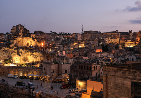 Matera; Italy - September 17; 2019: Bond 25. Scene of a procession with extras carrying candles. from the movie No Time to Die in Sassi; Matera; Italy. Редакционное