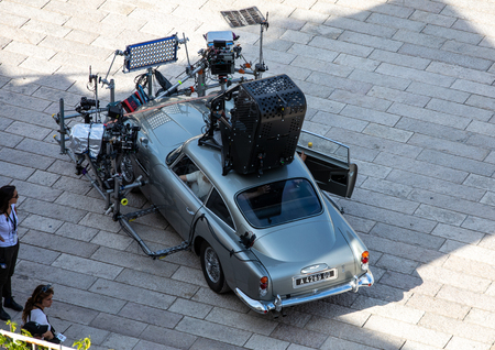 """Matera, Italy - September 15, 2019: Bond 25, Aston Martin DB5 equipped with all equipment for shooting chase scenes from the movie """"No Time to Die"""" in Sassi, Matera, Italy."""