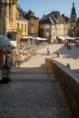 Sarlat, France - September 2, 2018: Historic houses surrounding Place de la Liberte in Sarlat la Caneda in Dordogne Department, Aquitaine, France Redakční