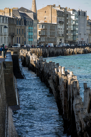 Saint-Malo, France - September 12, 2018: Big breakwater, 3000 trunks to defend the city from the tides, Plage de l'Éventail beach in Saint-Malo, Ille-et-Vilaine, Brittany, Editorial