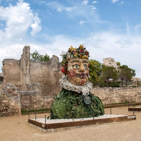 Les Baux, France - June 26, 2017: The artwork, titled Spring is Four Seasons three-dimensional interpretations created by Philip Haas and inspired by a set of paintings with the same titles by Italian Renaissance artist Giuseppe Arcimbaldo. Each season is represented by the bust of an oversized figure composed of fruits, flowers, and other vegetation symbolic of that time of year.