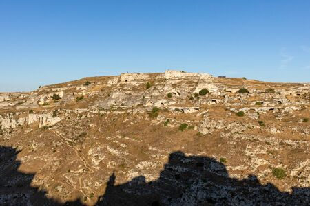 View of Gravina river canyon and park of the Rupestrian Churches of Matera with houses in caves di Murgia Timone near ancient town Matera (Sassi), , Basilicata,  Italy