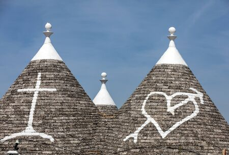 Stone roof of Trulli House in Alberobello, Italy. The style of construction is specific to the Murge area of the Italian region of Apulia (in Italian Puglia). Made of limestone and keystone. Фото со стока