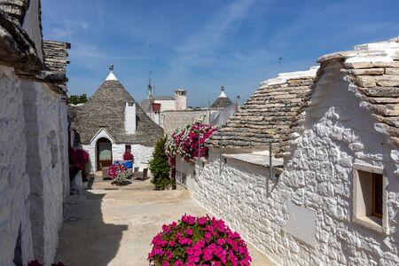 Trulli village in Alberobello, Italy. The style of construction is specific to the Murge area of the Italian region of Apulia (in Italian Puglia). Made of limestone and keystone.