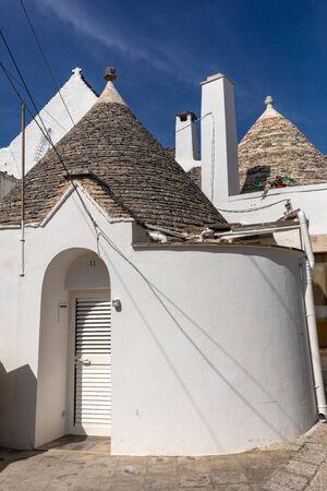 Alberobello, Italy - Septembet 16, 2019: Trulli village in Alberobello, Italy. The style of construction is specific to the Murge area of the Italian region of Apulia (in Italian Puglia). Made of limestone and keystone.