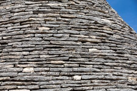 Stone roof of Trulli House in Alberobello; Italy. The style of construction is specific to the Murge area of the Italian region of Apulia (in Italian Puglia). Made of limestone and keystone.