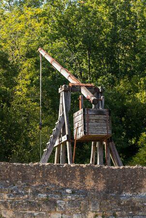 Medieval trebuchet at Chateau de Castelnaud, medieval fortress at Castelnaud-la-Chapelle, Dordogne, Aquitaine, France
