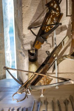Castelnaud, Dordogne, France - September 7, 2018: Antique crossbows displayed in the rooms of Castelnaud castle. medieval fortress at Castelnaud-la-Chapelle, Dordogne, Aquitaine, France Editöryel