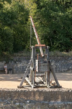 Castelnaud, Dordogne, France - September 7, 2018: Medieval trebuchet at Chateau de Castelnaud, medieval fortress at Castelnaud-la-Chapelle, Dordogne, Aquitaine,  France Redakční