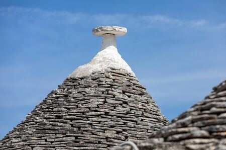 Stone roofs of Trulli Houses in Alberobello; Italy. The style of construction is specific to the Murge area of the Italian region of Apulia (in Italian Puglia). Made of limestone and keystone.
