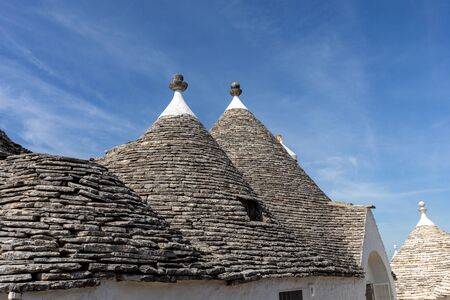 Stone roof of Trulli House in Alberobello, Italy. The style of construction is specific to the Murge area of the Italian region of Apulia (in Italian Puglia). Made of limestone and keystone. Reklamní fotografie