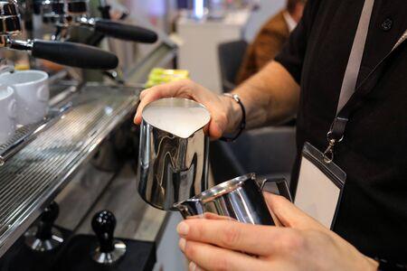Barista making coffee at coffee machine