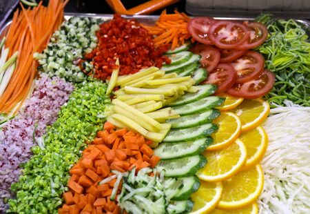 Different raw shredded vegetables and fruits as an example of a healthy diet