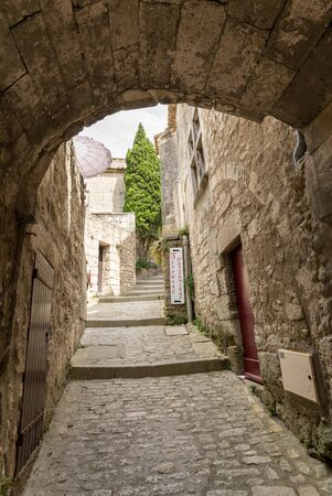 Les Baux de Provence, France - June 26, 2017: Street in medieval village of Les Baux de Provence. Les Baux is now given over entirely to the tourist trade, relying on a reputation as one of the most picturesque villages in France