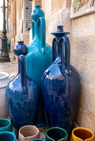 Hand-painted colorful traditional ceramics at a shop display in Polignano a Mare. Apulia. Italy