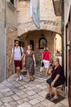 Polignano a Mare, Italy - September 17, 2019:  People walking on the charming and romantic historic old town of Polignano a Mare, Apulia, southern Italy