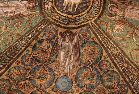 Ravenna, Italy - Sept 11, 2019: Interior of Basilica of San Vitale, which has important examples of early Christian Byzantine art and architecture.Ceiling mosaic of the presbitery with the agnus dei in the middle. San Vitale Ravenna