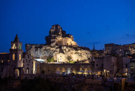 Matera, Italy - September 17, 2019: Night view at Church of San Pietro caveoso and on the top of the hill of Church of Saint Mary of Idris in Matera, Basilicata, Italy Editorial