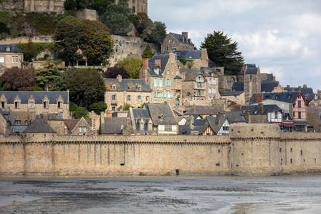 Le Mont Saint-Michel, medieval fortified abbey and village on a tidal island in the Normandy, France, at low tide Editoriali