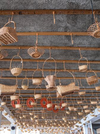 Wicker baskets on sale in a factory shop in Camacha on Madeira Island. Portugal