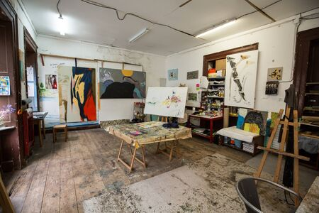 Funchal, Madeira, Portugal - September 8, 2016:  Open plan artists studio with easel, watercolours and hanging paintings in Funchal on Madeira. Portugal