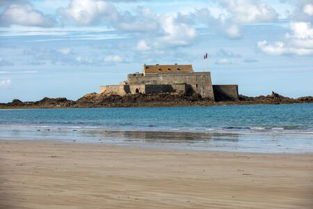 View of the Fort National in Saint Malo a tidal island in the English Channel at high tide. Brittany, France