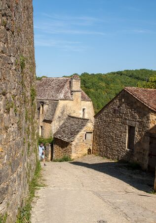 Beynac et Cazenac, France - September 4, 2018: Typical French townscape with ancient housest and cobblestone street in the traditional town Beynac-et-Cazenac, France