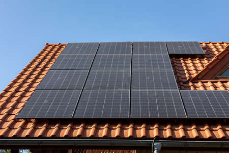 Solar electric panels on a house roof in Ochojno. Poland