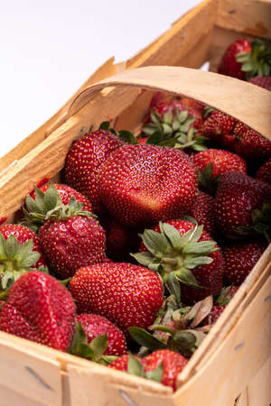 Close-up of a basket full of ripe strawberries