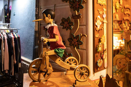 Cesenatico, Emilia Romagna, Italy - Sept 9 2019:  Painted wooden marionette dolls of the figure of Pinocchio  in a souvenir shop in Cesenatico. Italy. Pinocchio's long nose symbolized a lie.