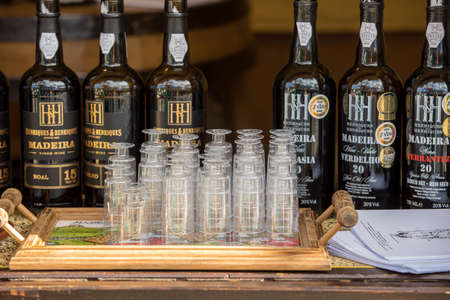 Funchal, Madeira, Portugal - April 19, 2018: Bottles of Madeira Wine at a street market stall in Funchal, Madeira. Portugal.