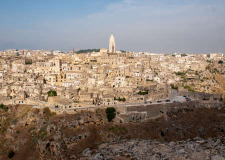 Panoramic view of Sassi di Matera a historic district in the city of Matera, well-known for their ancient cave dwellings from the Belvedere di Murgia Timone, Basilicata, Italy